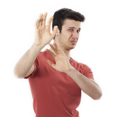 Closeup portrait of scared man raising hands up in defense