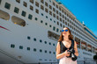 Woman tourist near the big cruise liner - 82012335