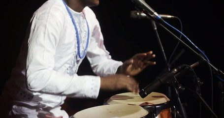 African man singing and playing ethnic drums 11