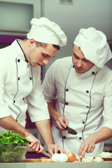 Cooking process concept. Portrait of two funny working men