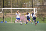 She shoots. The keeper saves it.