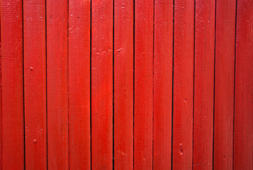 red painted wooden fence