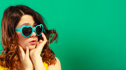 Girl in green sunglasses portrait