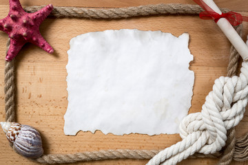 empty piece of paper with border of ropes, knots and seashells