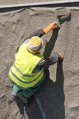 street worker repairing sidewalks and pipelines in the city