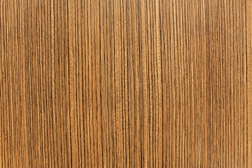 A wooden polished background with vertical dark stripes
