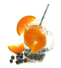 Healthy vitamin water with oranges and blueberries in a jar