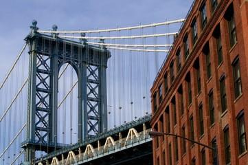 Manhattan Bridge and red brick building.