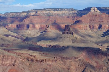 Clouds casting shadows over Grand Canyon.