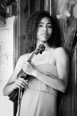 Black and white portrait of woman with violin outdoors
