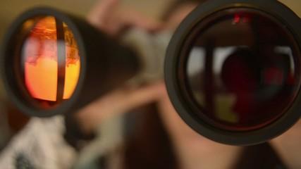 Someone with binoculars