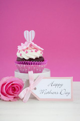 Happy Mothers Day pink and white cupcake.