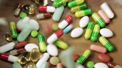 Multitude of colorful pills and tablets piling up