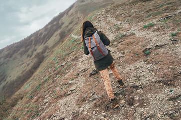 Hiker woman walking up mountain