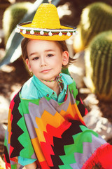 Boy dressed in Mexican costume against the background of a