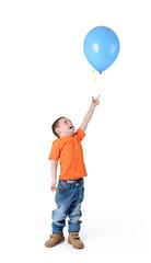 Little boy holding blue balloon on white background