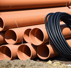 Plastic pipes and cable construction materials