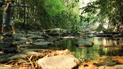 birdwatcher walking in rain forest