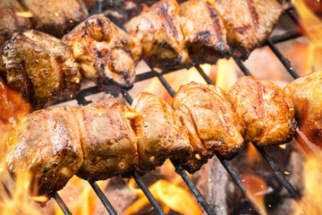 Delicious meat skewer on grill