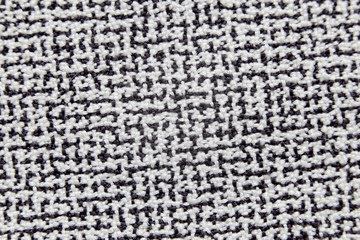 Surface of fabric in black and white color.