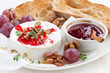 camembert with berry jam and toasts on plate - 82032538