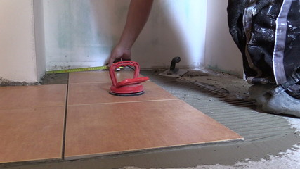 man measure with centimeter left floor area Home renovation.