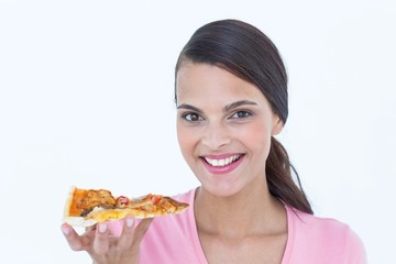 Beautiful woman eating a pizza