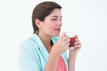 Peaceful woman drinking cup of tea