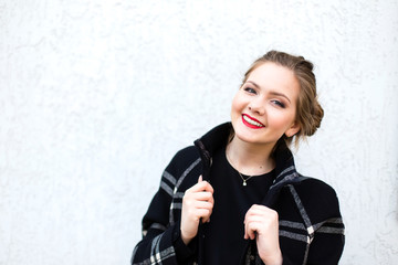 portrait of a smiling girl in high key against a white wall