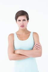Angry woman looking at camera with arms crossed