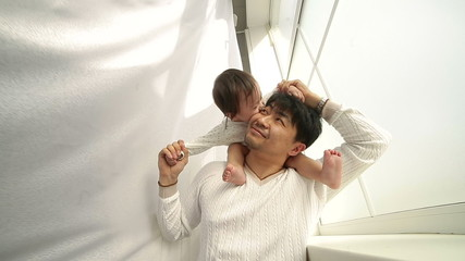 father playing with adorable baby