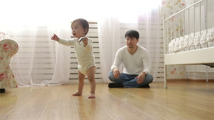 father teaches baby to walk,dolly shot