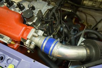 Details of old sports car engine