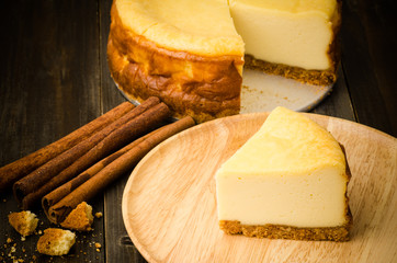 Cheesecake (New York cheesecake) on wooden plate