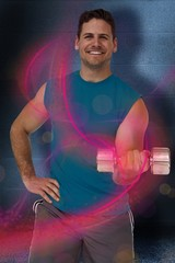 Fit man exercising with dumbbel