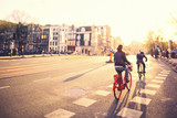Cycling in Amsterdam at Sunset - 82036501