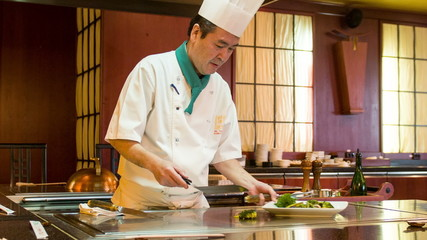 Chef working in Japanese restaurant