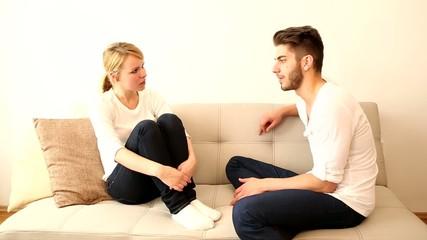 Young couple flirting on the Sofa