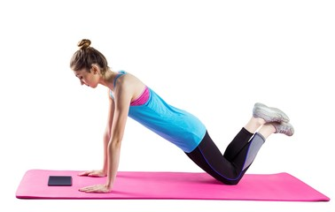 Fit woman doing press up on mat