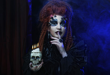 Gothic vampire woman with skull