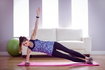 Fit woman doing side plank