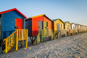 Sunrise at the famous colorful beach huts at Muizenberg Beach