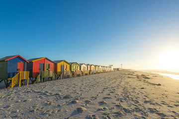 Sunrise at the famous colorful beach huts at Muizenberg Beach ou