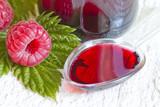 Raspberry syrup on spoon alternative medicine concept