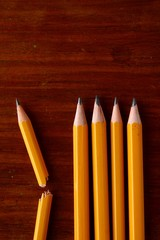 Four good pencils and one broken pencil