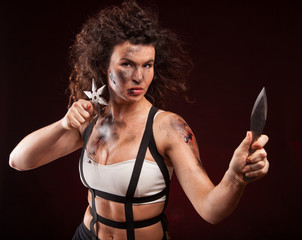 Portrait image of an abused woman holding a sharp knife
