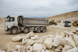 Trucks and bulldozers in quarry