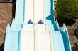 People having fun, sliding at water park
