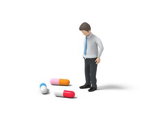 薬に悩む男性