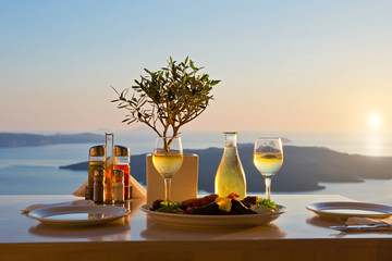 Dinner for two on a sunset background